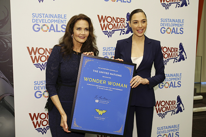 Wonder Woman, past and present, Lynda Carter and Gal Gadot pose with the Ambassadorship plaque.