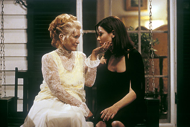 Ellyn Burstyn and Sandra Bullock sitting in a porch swing