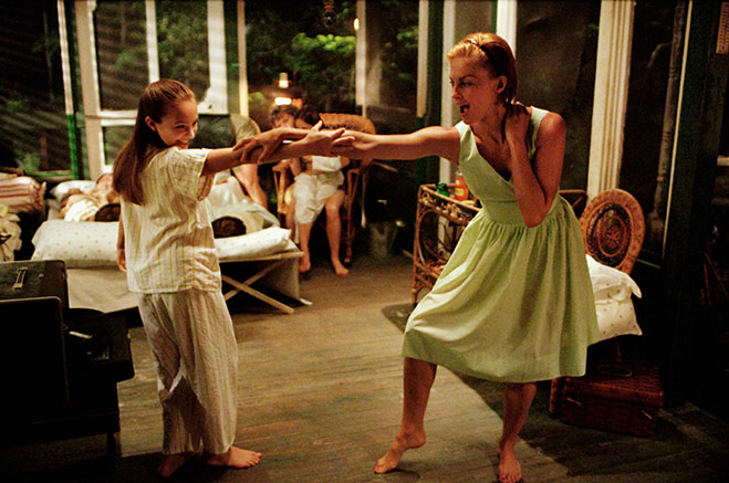 Ashley Judd dancing with girl