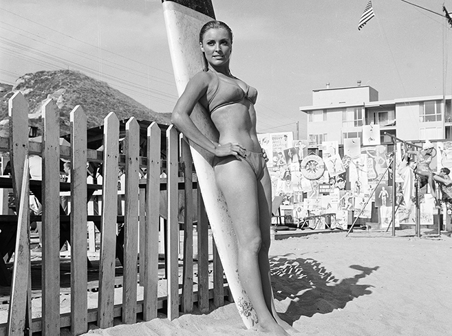 the stunning Sharon Tate in a publicity shot for the 1967 beachcombing romp Don't Make Waves, also starring Tony Curtis. Tate was sadly and viciously murdered by the Manson Family two years later when her career was just taking off.