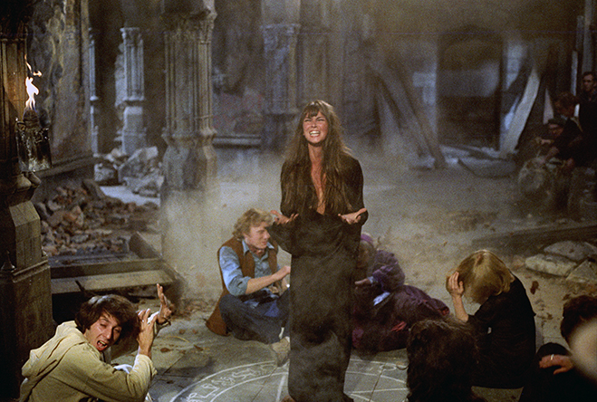 Screaming Caroline Munro as Laura standing in devil's circle