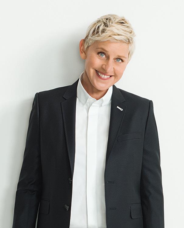 Ellen DeGeneres standing in front of white background