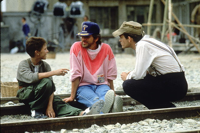 Thirteen-year-old Christian Bale pictured on the set of 1987's Empire of the Sun with director Steven Spielberg and co-star John Malkovich
