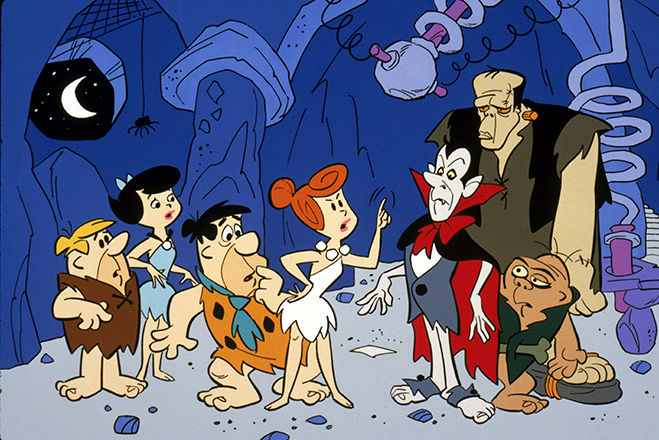 Full shot of Wilma Flintstone talking to Count Rockula and Frankenstone while Fred Flintstone stands behind her