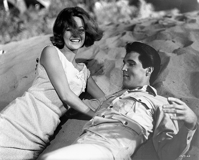 "Shelley Fabares and Elvis Presley have a sandy beach laugh during the musical number, ""Do the Clam,"" in 1965's Girl Happy."