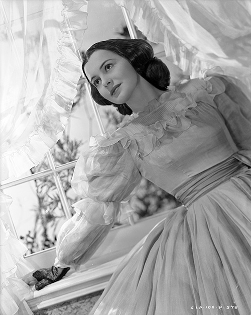 In a publicity photo as Melanie for Gone with the Wind