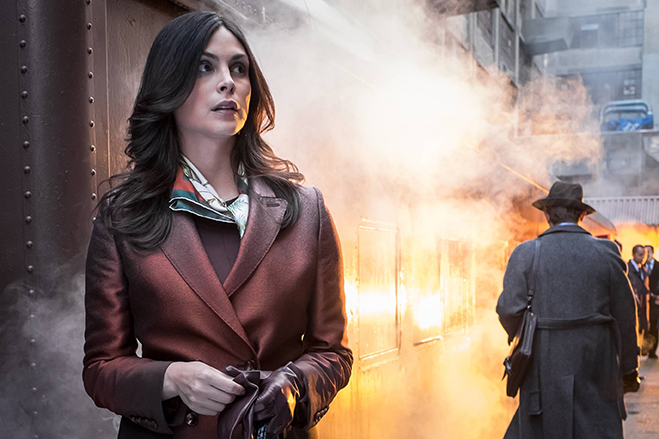 Morena Baccarin as Leslie Thompkins standing on a train platform in Gotham