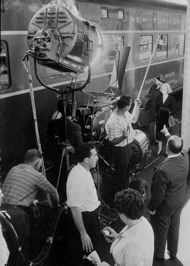 hitchcock (bottom right) directs his two stars—Cary Grant and Eva Marie Saint—as they board the 20th Century Limited, the world's most famous train at the time.