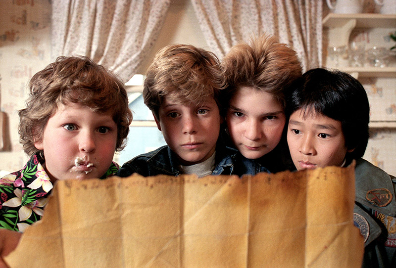 "Jeff Cohen as Chunk, Sean Astin as Mikey, Corey Feldman as Mouth and Ke Huy Quan as Data in ""The Goonies."""