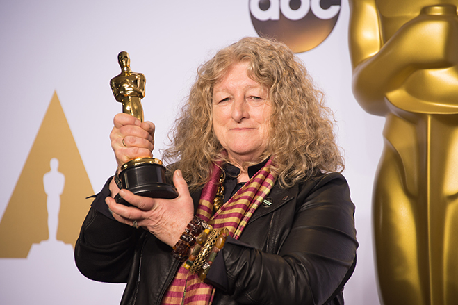 Jenny Beavan holding her Oscar for Mad Max: Fury Road