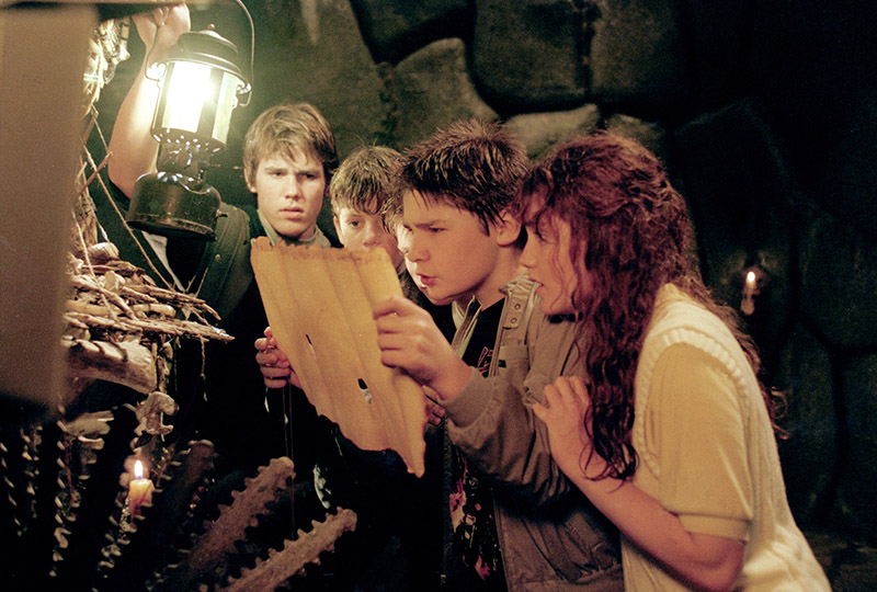 "Josh Brolin as Brand, Sean Astin as Mikey, Corey Feldman as Mouth and Kerri Green as Andy in ""The Goonies."""