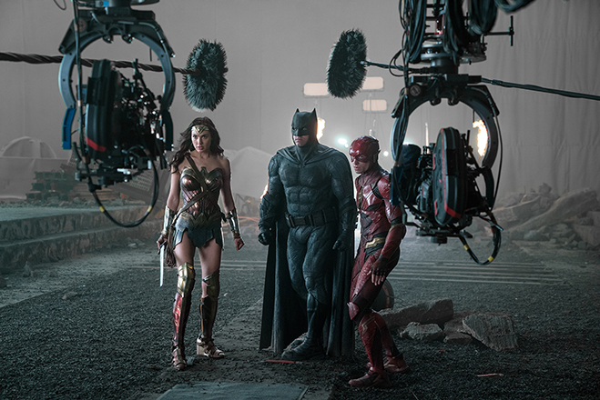 Gal Gadot, Ben Affleck and Ezra Miller pictured during a shoot on the set.