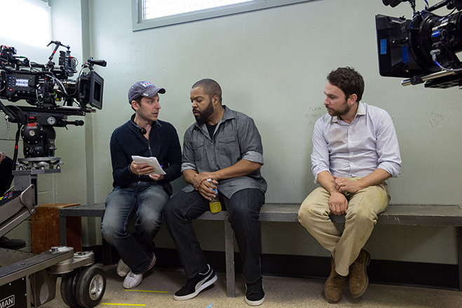 Director Richie Keen goes over script notes with stars Ice Cube and Charlie Day on the set of Fist Fight.
