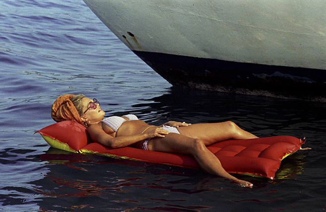"Dyan Cannon relaxes beside the yacht named ""Sheila"" in the brilliant 1973 whodunnit The Last of Sheila that features countless exotic locales (and murder!)."