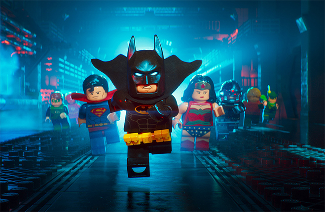 LEGO Batman running forward with Justice League behind him