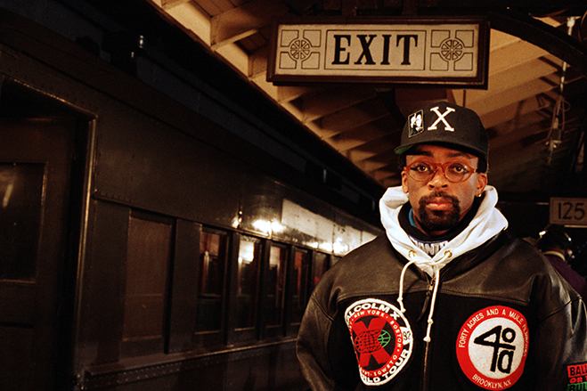 Spike Lee standing in a subway station