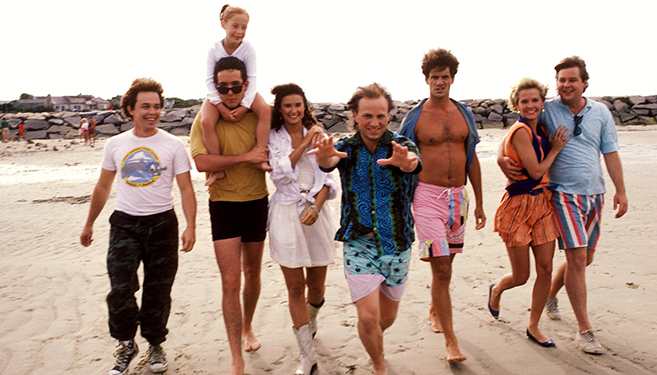 Full publicity shot of Curtis Armstrong as Ack Ack, John Cusack as Hoops McCann carrying Kristen Goelz as Squid, Demi Moore as Cassandra, Bob Goldthwait as Egg, Tom Villard as Clay, Kimberly Foster as Cookie Campbell, Joel Murray as George in the 1986 rom