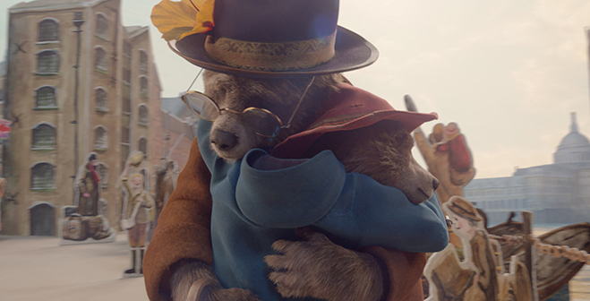 Aunt Lucy voiced by IMELDA STAUNTON and Paddington voiced by BEN WHISHAW in a loving embrace