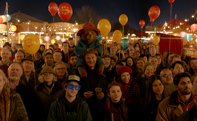 "(Front/center L-R) JULIE WALTERS as Mrs. Bird, SAMUEL JOSLIN as Jonathan Brown, Paddington voiced by BEN WHISHAW, HUGH BONNEVILLE as Henry Brown, MADELEINE HARRIS as Judy Brown and SALLY HAWKINS as Mary Brown in the family adventure ""PADDINGTON 2"""