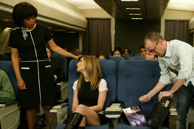 Full shot in airplane of Paula Newsome as Flight Attendant, Jennifer Aniston as Rachel and Jim Rash as Male Passenger.