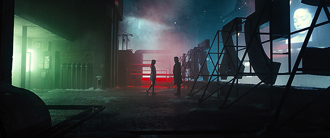 ANA DE ARMAS as Joi and RYAN GOSLING as K on one of the Blade Runner 2049 sets.