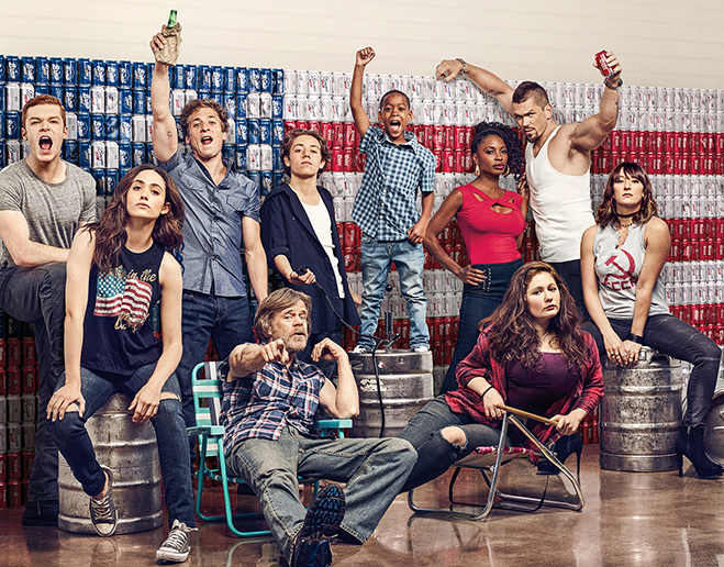 The cast of Shameless in front of an American flag made of beer cans