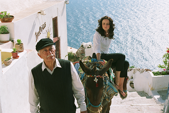 George Touliatos as Bapi leads Alexis Bledel (as Lena) to her grandparent's house in Greece during her summer vacation in The Sisterhood of the Traveling Pants.