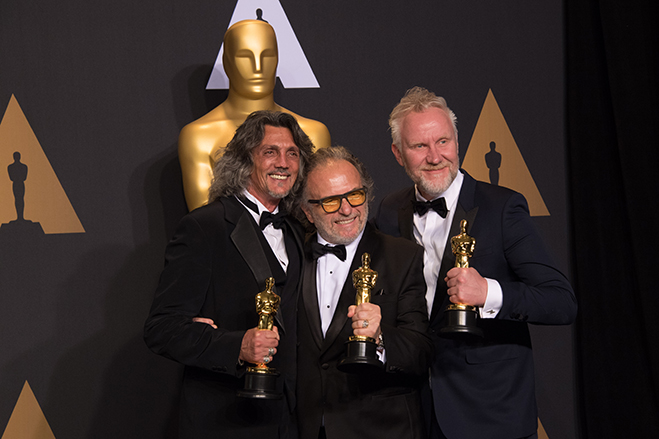 Giorgio Gregorini, Alessandro Bertolazzi and Christopher Nelson pose backstage with the Oscar® for Achievement in makeup