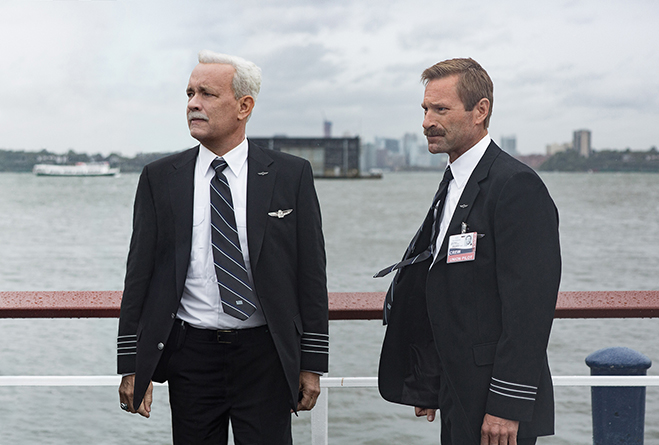 Tom Hanks and Aaron Eckhart surveying the scene after their famous water landing in sully.