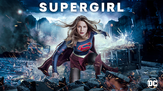 Melissa Benoist as Supergirl kneeling in debris of city destruction