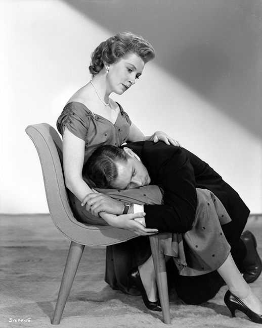 Deborah Kerr as Laura Reynolds sitting, John Kerr as Tom Robinson Lee with head in her lap.