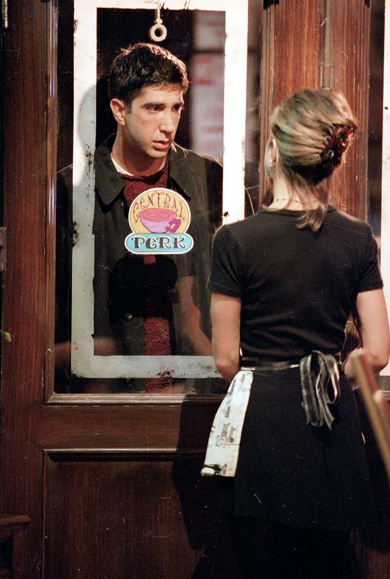 "David Schwimmer as Ross looking through window of Central Perk coffee house at Jennifer Aniston as Rachel from episode ""The One Where Ross Finds Out""."
