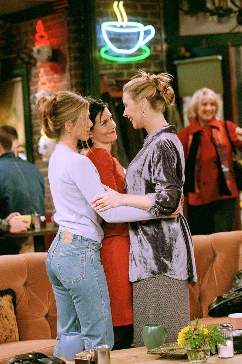 "Jennifer Aniston as Rachel, Courteney Cox as Monica and Lisa Kudrow as Phoebe in Central Perk coffee house from episode ""The One With Phoebe's Uterus""."