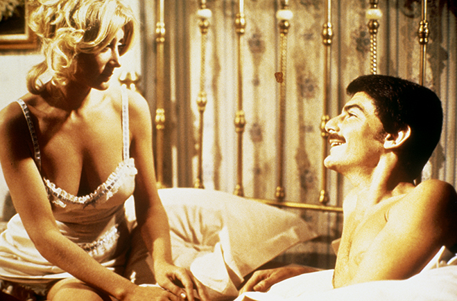 Medium shot of Linda Gaye Scott as Arlette in bed with Richard Benjamin as Peter Martin.